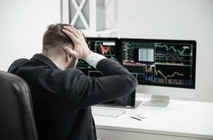 frustrated business man looking at share prices